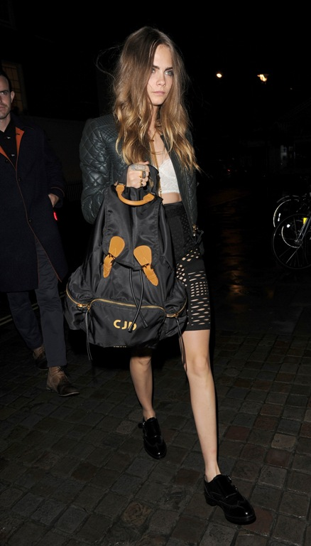 264687_543138_cara_delevingne_wearing_burberry_whilst_out_in_london